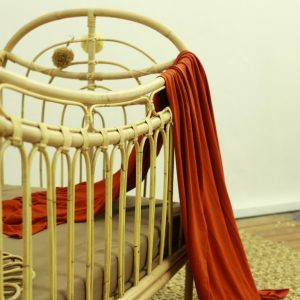 Rainbow rattan baby cot detail 1